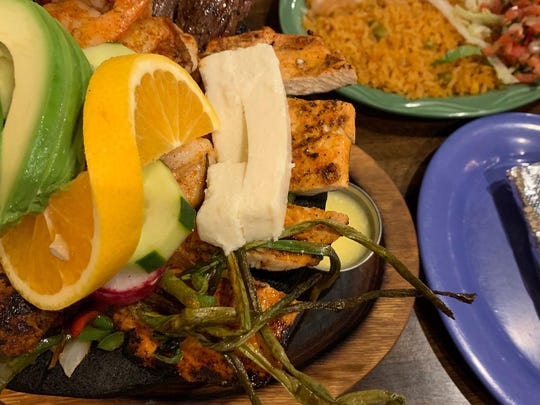 The Molcajete de la Casa is a feast with grilled cactus, green onion, chicken and beef as well as shrimp and chorizo.