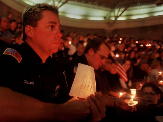 BOND OF BROTHERHOOD:  Sparks firefighters Thom Kowatch, left, and Zach Larkin listen to speakers during the vigil. Nearly 300 firefighters were killed in the attack on the World Trade Center towers.