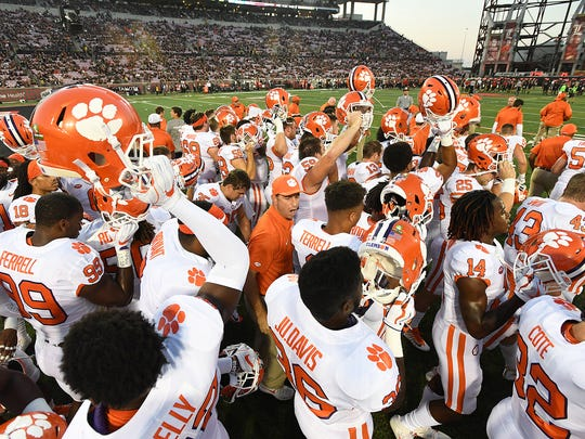 Clemson head coach Dabo Swinney huddles with his team during pre-game on Saturday, September 16, 2017 at Louisville's Papa John's Cardinal Stadium.