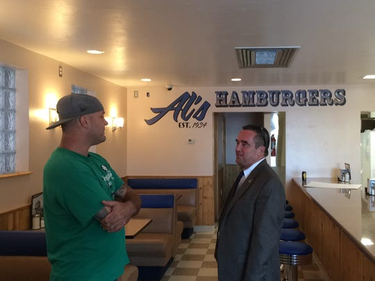 Al's Hamburger owner Michael Wirz talks with Green Bay Mayor Jim Schmitt, who stopped at the restaurant on Monday.