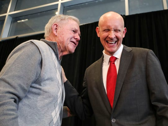 Denny Crum (left) shares a laugh with Chris Mack at Mack's introductory press conference in March 2018. The two coaches have a good relationship.