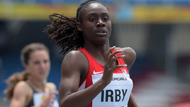 Pike's Lynna Irby runs the fastest semifinal 400-meter race in the under-17 World Youth Championships in Cali, Colombia.