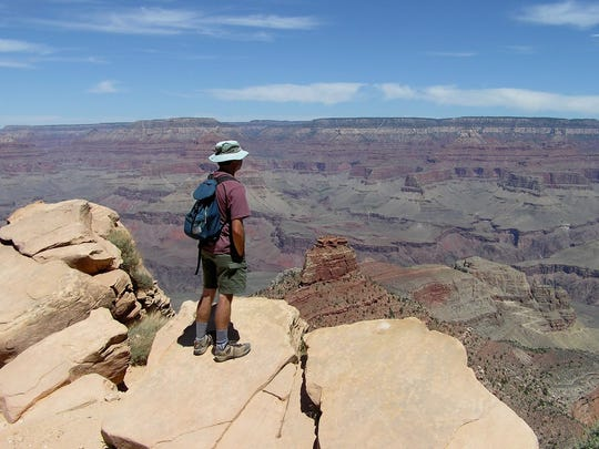 The reporter takes in the view from Ooh Aah Point less