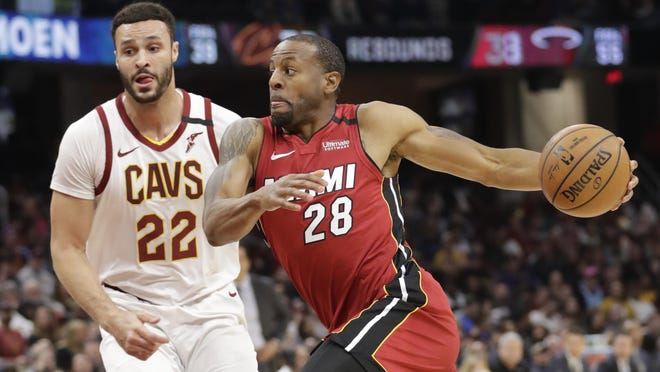 Miami Heat's Andre Iguodala (28) drives past Cleveland Cavaliers' Larry Nance Jr. (22) in the second half of an NBA basketball game, Monday, Feb. 24, 2020, in Cleveland