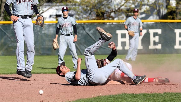Harrison's Mike Hendler (16) misses the tag on Rye's