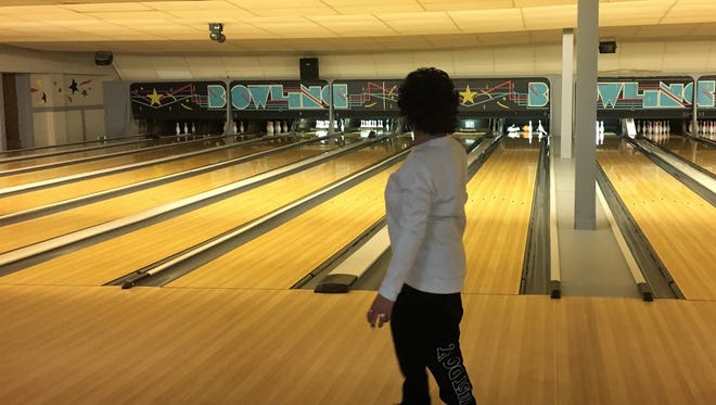 Former Macy's sales manager Tracey Rogers scores during a bowling night following the final day of operations at the Macy's store at Birchwood Mall in Fort Gratiot, Michigan on March 25, 2018. After locking the doors for the last time, the store's employees gathered at Zebra Lounge and Bowling in Port Huron to mark the end of an era.