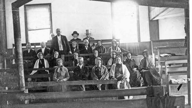 This is one of the few known photographs depicting the interior of the 1816 meetinghouse circa the late 1800s. The man standing near the back without a hat is John Cornell, a Quaker minister from Mendon. He was a popular and well-known speaker of the day at Friends' meetings throughout the United States.