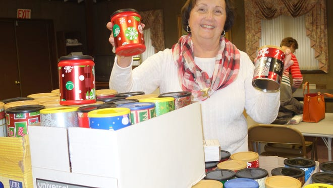 Diane Ragone, chairman of the Woman's Club of Vineland's cookie/candy project, prepares containers for delivery to the New Jersey Veteran's Memorial Home in Vineland.