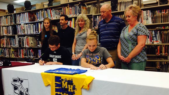 Enka seniors Matt Palmer, left, and Chelsey Melton will continue their athletic careers in college.