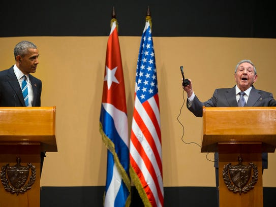 Cuban President Raul Castro gestures as he calls to