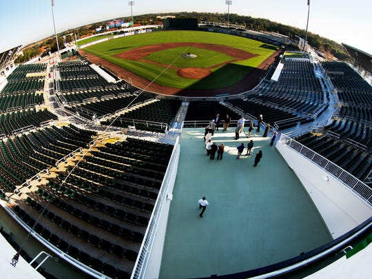 Members of the Tourist Development Council stand in Hammond Stadium's new grand entrance during a tour of the facility in February.