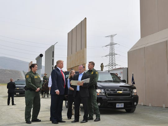 TOPSHOT - US President Donald Trump inspects border
