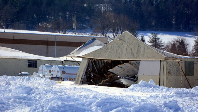 Heavy snow from Jonas caused the collapse of at least two hangers at York Airport, Sunday January 24, 2016. (John A. Pavoncello - The York Dispatch)