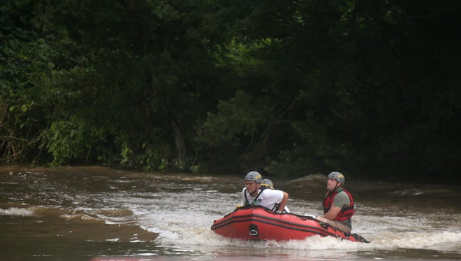 Rescue workers continue to look for Dreyton Sims on the Duck River on Wednesday, July 5, 2017, in Shelbyville, Tenn. the day after he went missing