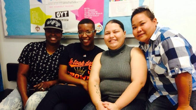 Nikki Dismuke, Deasia Johnson, Kathleen M. Aguero and Loretta M. Pangelinan pose for a photo at Public Health. Dismuke and Johnson were wed today.