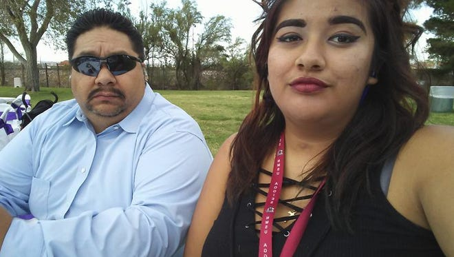 Roger Avalos, left, and his late daughter, Briana Chavez, attend a wedding in August 2016.