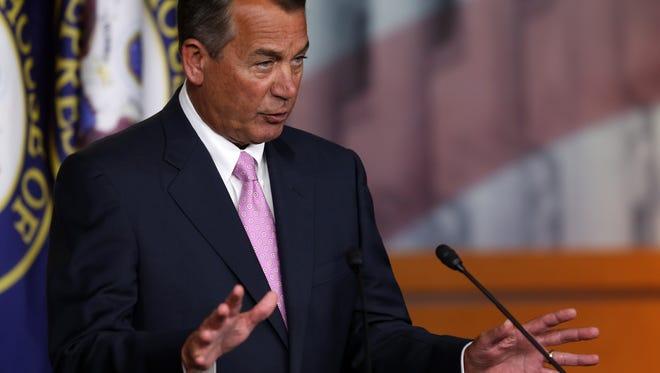 House Speaker John Boehner discusses President Obama's plan Thursday.
