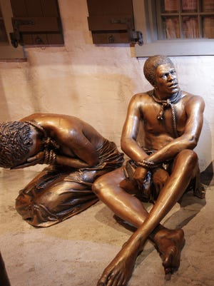 These bronze statues on display at the National Underground Railroad Freedom Center represent the early period of African slaves being brought to what would become the United States. This year marks the 400th anniversary of enslaved Africans being brought against their will to the British colonies at Jamestown, Virginia.