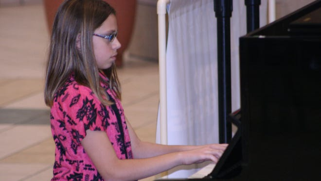 Playing her Christmas music at center court of the Forest Mall is Marissa Gruber, student of Barb Gray of Piano Playground.  Marissa is just one of many students who will be sharing her talents the weekend of Dec. 2 through 4 when the Fond du Lac Piano Teachers team up with Forest Mall to bring Christmas music to all the shoppers. For more information on lessons with Barb Gray, please contact her at pianoplayground@charter.net or call 920-979-9229.