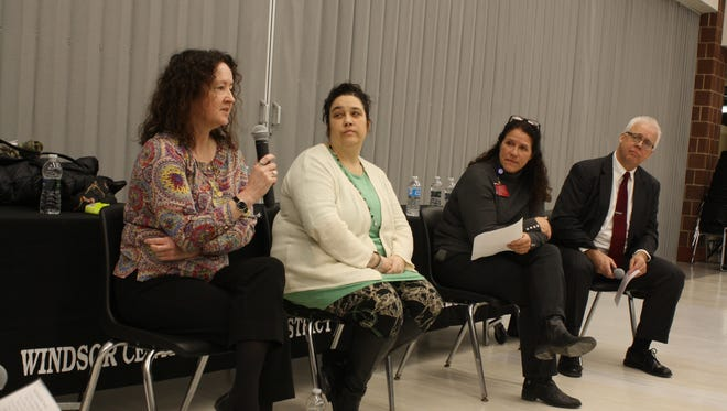 Sarah Bridgeman, Cara Fraser, Jill Alford-Hammitt and Kevin Rollo, lead Wednesday's panel on mental health and suicide at Windsor High School.