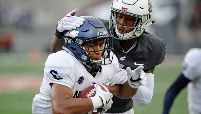 Wolf Pack defensive back Nephi Sewell jumps the route for an interception in front of Washington State receiver Davontavean Martin during last season's game.