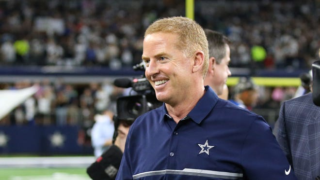Dallas Cowboys head coach Jason Garrett smiles after the overtime victory against the Philadelphia Eagles at AT&T Stadium.