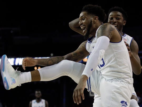 Seton Hall guards Myles Powell, front, with Myles Cale,
