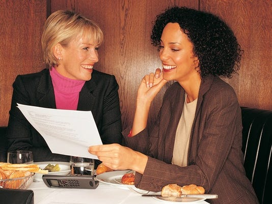 Two businesswomen having lunch meeting