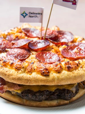 """In this March 22, 2016 photo released by the Atlanta Braves, the """"Burgerizza"""" is shown in Atlanta."""