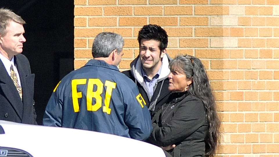 CHARDON, OH - FEBRUARY 27:  A FBI agent speaks with