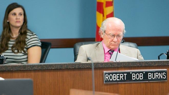 Arizona Attorney General Mark Brnovich will not seek the removal of utility regulator Robert Burns for his lobbyist record.