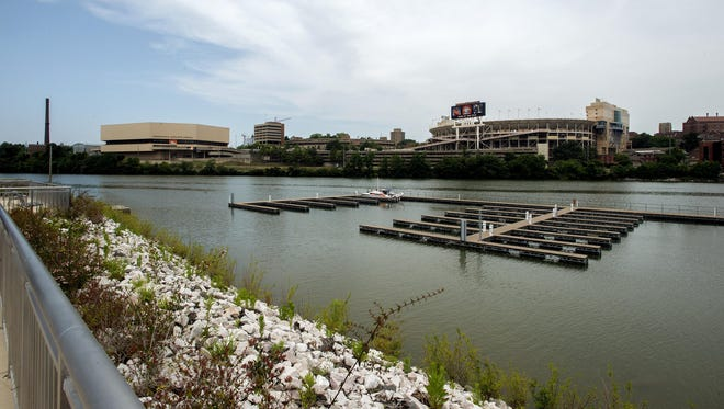 A boat is docked in front of riverfront condos on the Tennessee River in Knoxville in June.