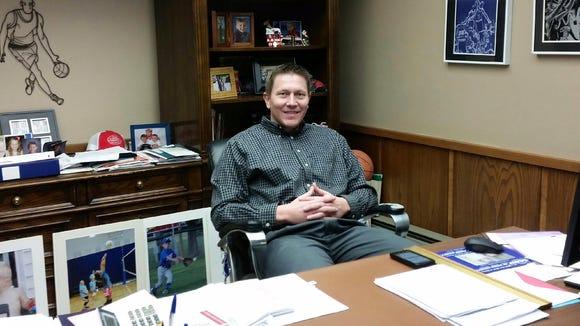 Chris Kingsbury sits at his desk.
