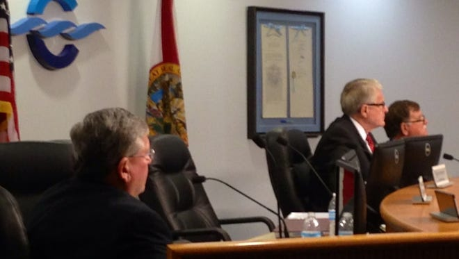 Canaveral Port Authority Chief Executive Officer John Walsh, and two of his critics, Canaveral Port Authority Chairman Jerry Allender and Secretary/Treasurer Tom Weinberg, transact business at Wednesday Port Authority meeting, shortly after Walsh agreed to resign, effective Jan. 21.