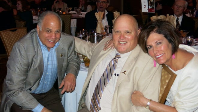 Gerald Savoie, Marshall and Carolyn Pearce at Miracles on the Red.