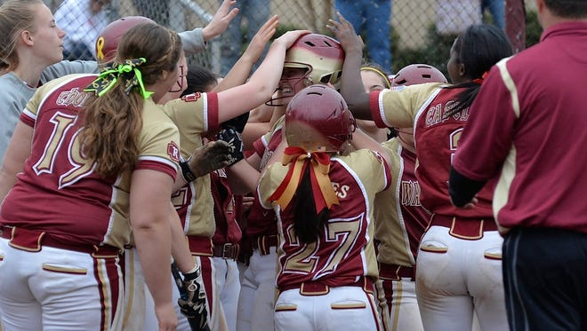 Riverdale softball players celebrate with teammate Emily Burns, center, after she hit her first career home run for the Lady Warriors in their 6-1 win over Oakland.