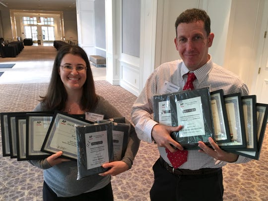 Molly Corfman and Daniel Carson of the News Herald and The News-Messenger won 14 awards at the annual APME newspaper competition.