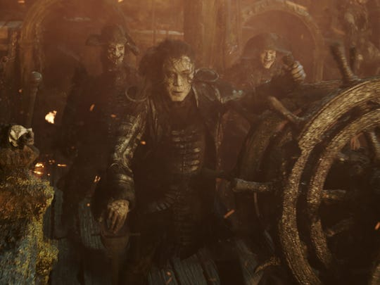 Captain Salazar (Javier Bardem, center) haunts the