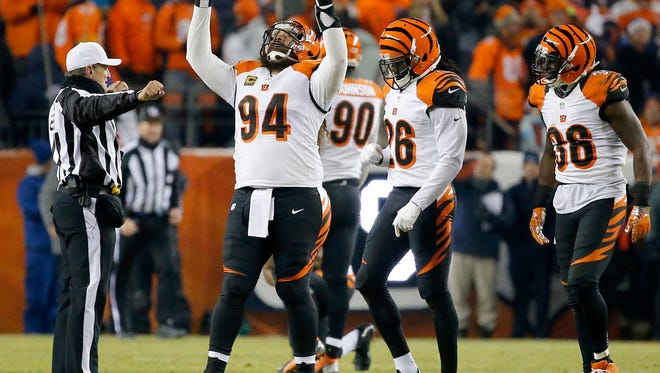 Cincinnati Bengals defensive tackle Domata Peko (94) celebrates after Denver Broncos kicker Brandon McManus' (8) field-goal attempt is no good as time expires in the fourth quarter of the NFL Week 16 game between the Denver Broncos and the Cincinnati Bengals at Sports Authority Field at Mile High in Denver on Monday, Dec. 28, 2015. The Bengals fell to the Broncos, 20-17, in overtime.