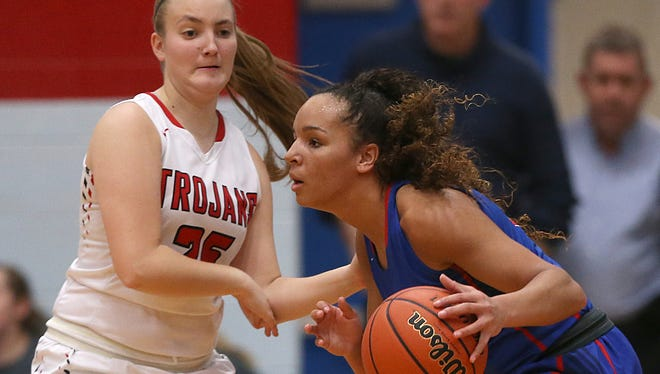 Kayana Traylor, right, scored a team-high 19 points to lead Martinsville past Center Grove.