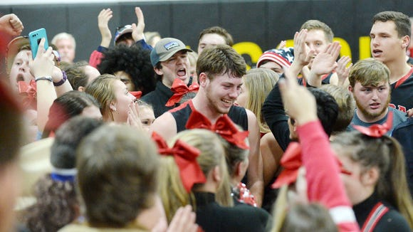 Pisgah's Trey Morgan, center, is surrounded by fans after Friday's 78-77 win at Tuscola.