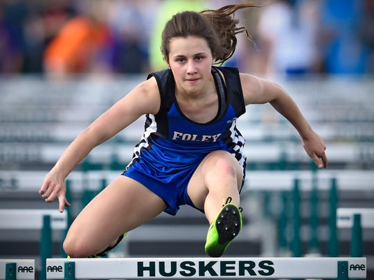 Rachael Batty competes in the 100-meter hurdles during the Subsection 5A track meet Tuesday in Holdingford.