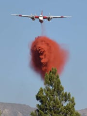 A Cal Fire air tanker makes a drop on the Boca Fire in August.