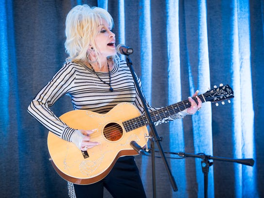 Dolly Parton sings a song at the newly renamed My People