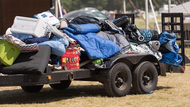 Volunteers from the community and local churches gather up Firefly attendees' unwanted sleeping bags, blankets, towels, shoes, and various other items for Code Purple to aid the homeless in Delaware. A rally on Monday in Dover seeks to draw attention to the plight of the homeless in central and southern Delaware.