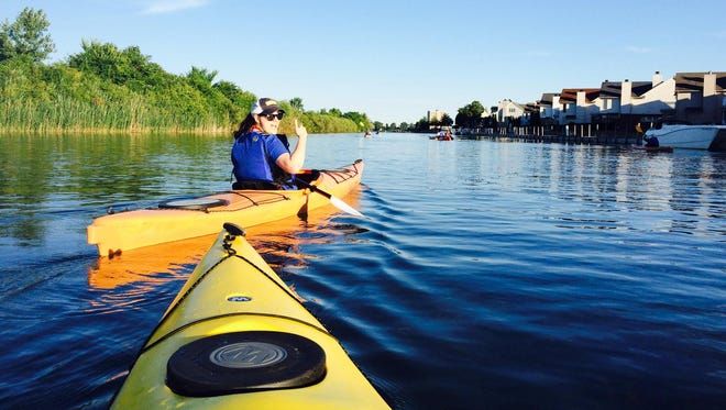 Paddling Detroit's canals on a sunset kayak tour.