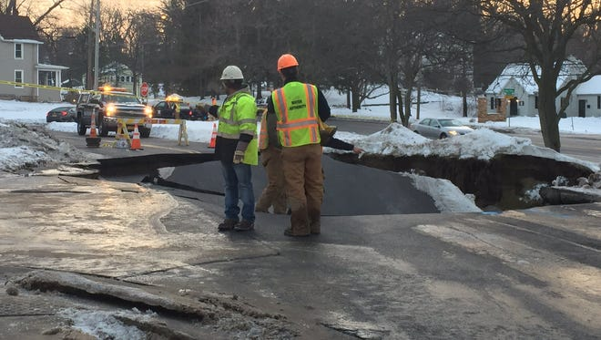 A sinkhole closed parts of Penfield Road.