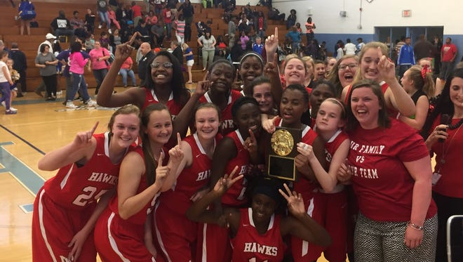 Rosman alum Cassie Green coaches the Mount Holly Middle School girls basketball team.