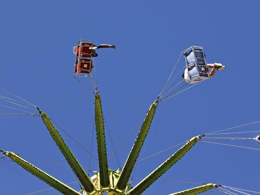 The 100-foot tall Vertigo Swing Ride is part of the