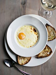 Chef Steven Satterfield serves this legendary farm egg at Atlanta's Miller Union. A solitary egg is suspended in celery-infused cream and baked into a custard-esque treat.